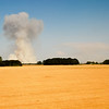 """<span id=""""title"""">Fire</span> Although it looks a bit like a mushroom cloud, it was some sort of fire in Southern Oregon. Probably agricultural? This shot taken from the moving train."""