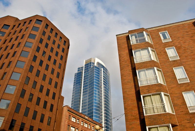 """<span id=""""title"""">Brick vs Glass</span> A neat view of a skyscraper past 2 brick buildings at 1st/Stewart. I tried to figure out what the glass building is, but it's very new and didn't show up on the maps I looked at."""