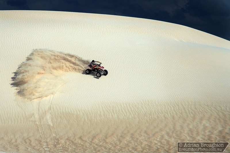 George having some fun in the dunes on Ivan's quad bike.