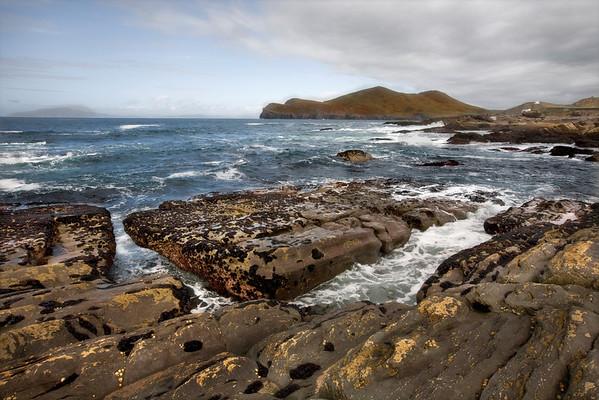 Seawweed encrusts the massive rocks that jut into the sea on Valentia Island.