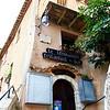 Le Troubadour restaurant with its stone arched entrance.