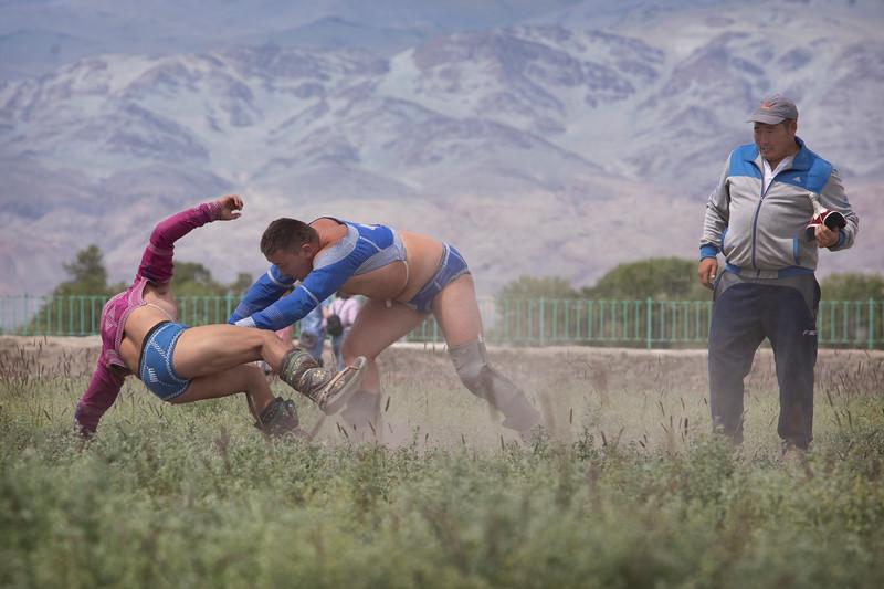Wrestling at a naadam festival at Tsengal