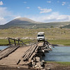 Crossing a collapsed wooden bridge
