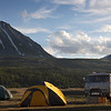 Golden hour over our tents and UAZ