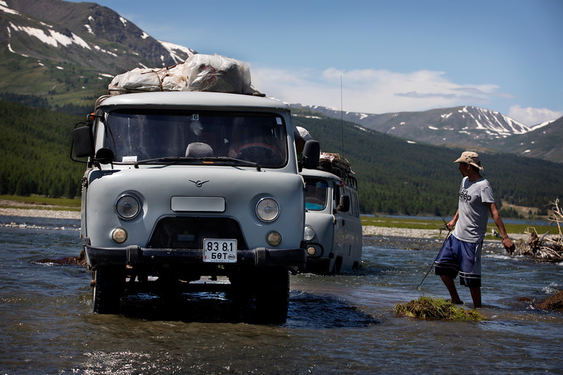 Towing a stranded UAZ that got stuck during a river crossing