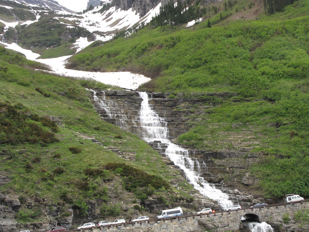 Waterfall flowing under the Going-to-the-Sun Road, near Logan Pass, Glacier National Park.