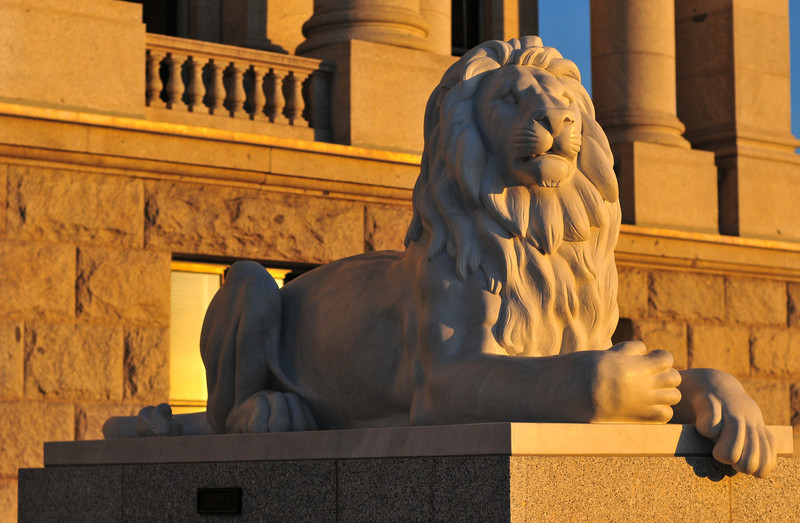 Lion of the State Capitol Building in Salt Lake City, Utah at sunset. The building houses the chambers of the Utah State Legislature, the offices of the Governor and Lieutenant Governor of Utah.