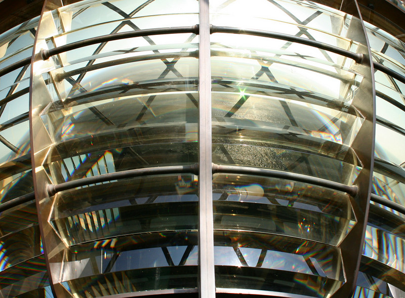 Portland Bill lighthouse.<br /> Look carefully and you can see the sea reflected in the glass.