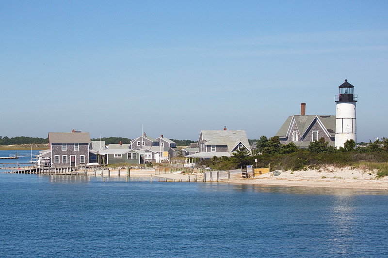 4067 On the way out of Barnstable Harbor we passed the Sandy Neck light and a cluster of gray-shake Cape Cod buildings.