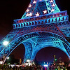 Paris: Eiffel Lower. Approach at night to the expansive base of the Eiffel Tower, Paris, 2008