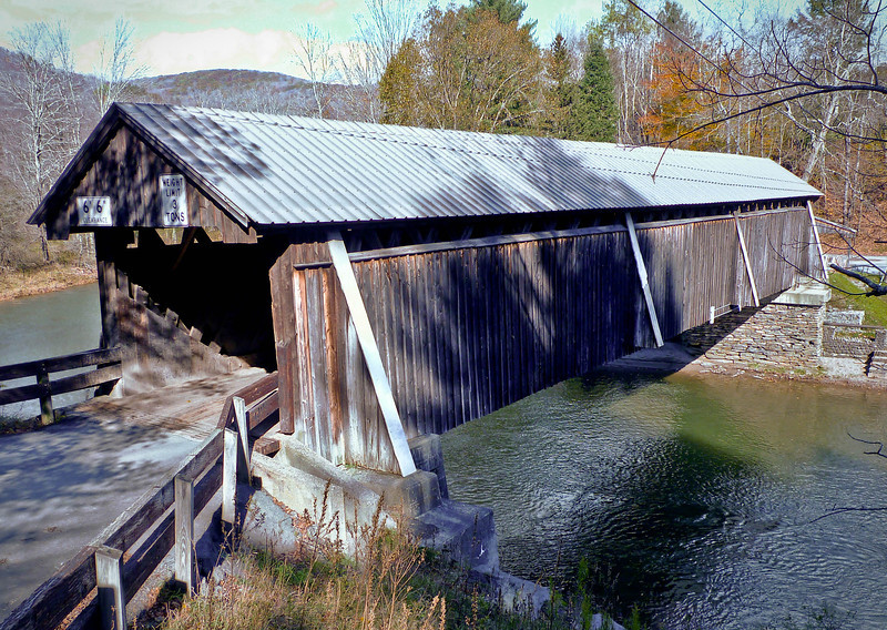 Beaverkill Covered Bridge, Rockland, NY<br /> <br /> North of the hamlet of Roscoe, the Beaverkill Bridge is a wooden covered span over the Beaver Kill in the Catskill Mountain town of Rockland in Sullivan County, New York. Built in 1865, its unusual modification of an earlier 19th-century lattice truss design contributes to the structure's architectural interest. In 2007 the National Register of Historic Places listed this particular bridge, the only one of four covered bridges in Sullivan county to receive the distinction.