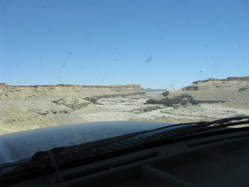 We traveled many miles along the dirt road, which took us through several washout areas and still no evidents of the other cemetery. Breaking over a rise I could see the road traverse a rather large dry riverbed.