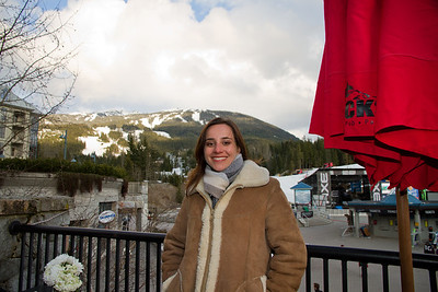 Margaret on the Balcony of Blacks Pub; Blackcomb Mountain in the Background