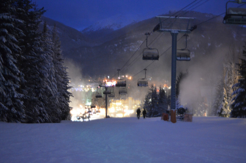 The Wizard lift at night with the glowing Upper Village in the background