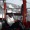 Lonely skier on the gondola