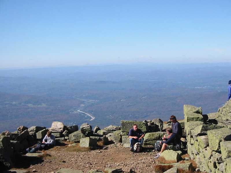 Top of Mount Lafayette. Out over the moutains. You can see the foundation of a former structure on the top of Mount Lafayette