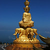 Mt Emei summit golden statue of Puxian Buddha that is wight of 660 tones. Mt. Emei, located in Suchuan province, China, stands at 3099 meters (10,167 feet), and is associated with Puxian Bodhisattva (Samantabhadra).