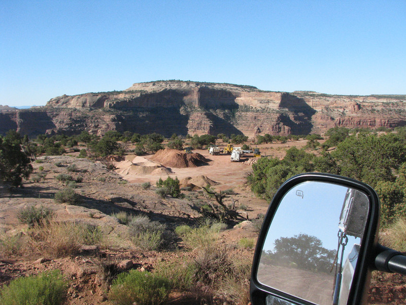 Dump trucks and road grader staging area next to Shafer Trail, what are they here for?