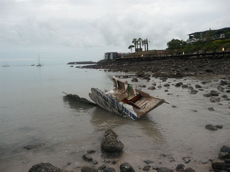 A broken boat washed ashore by the Volunteer Marine Rescue Whitsunday base in Cannonvale.