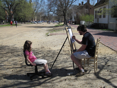 Getting her caricature drawn.