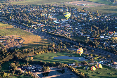 Nearby Yountville awakes to the morning sun.  Other balloons slowly rise in the morning air, with more to come.