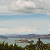 View toward the North West of the Bay from above the Telegraph Hill parking lot. The Statue is Columbus. The nearest island is Alcatraz. The cone-shaped island is Belvedere. The large island behind the American Flag is Angle Island. Angle Island and Alcatraz are National Park areas.