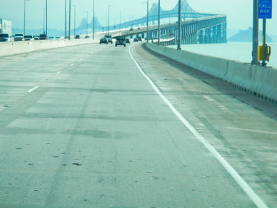No the San Rafael bridge is not tilting. It just looks like it. Wouldn't you, if you were 8.9 kms long.