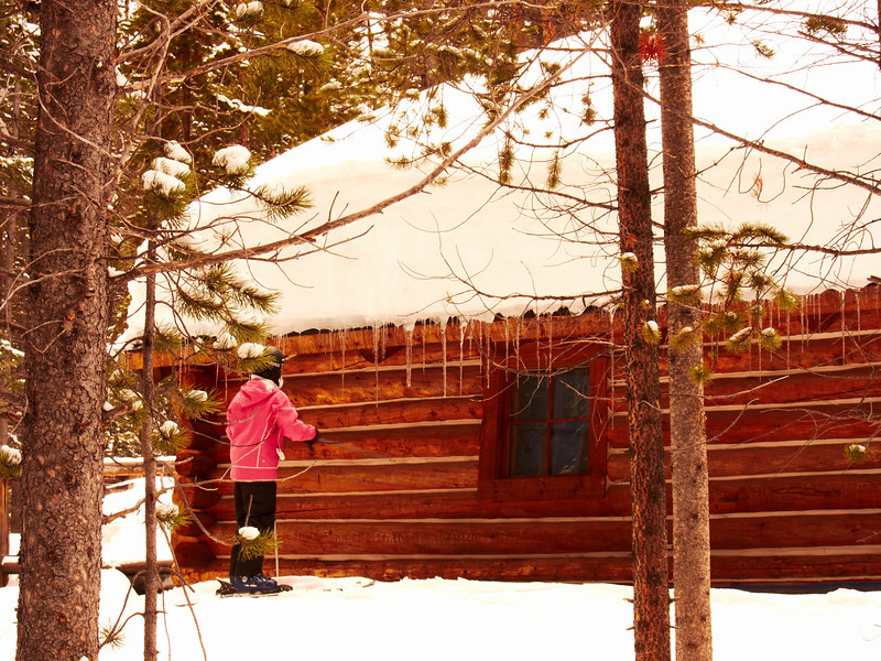 Josie about to attach the icicles on a remote hut