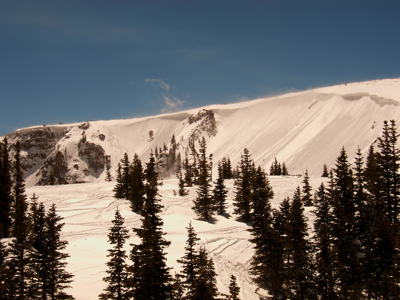 Up to the top left can be seen the tracks of a few madmen, skiing out of bounds with huge snow lips overhanging nearby