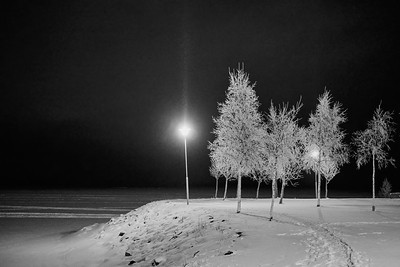 Last lights by the sea bw
