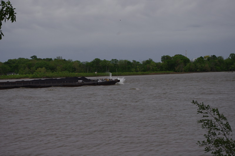 Tug with bargs pounding the water Le Claire, Iowa