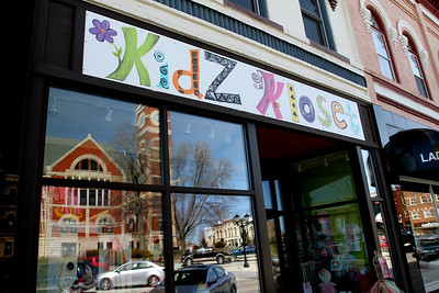 Kidz Klose with a reflection of downtown.