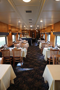 Reserved tables await  For actual dining, the train reached a scenic setting and stopped.