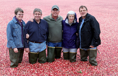 Kent hands his camera to a willing photographer and wades on in to the Ocean of Cranberries.
