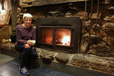 Sarah by the cozy fire at The Simpsons Restaurant