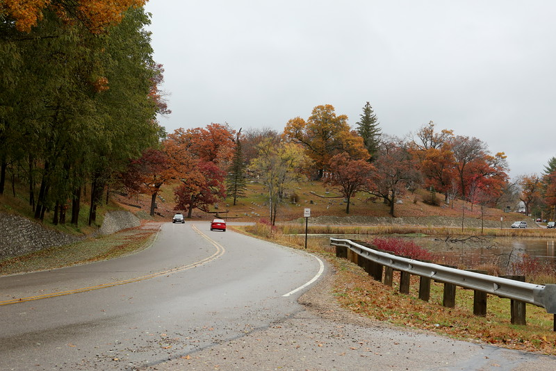 The curving road towards Waupaca passes a cemetery on the hill