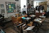 The era of wooden school desk and later the addition of iron supports is preserved here.