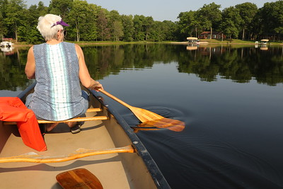 Early morning canoe ride with Sarah at the helm