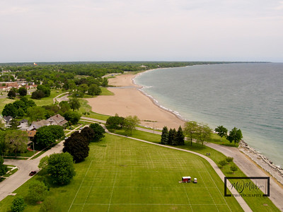 Looking North along Lake Michigan from Kennedy Park in Kenosha, Wisconsin.  The beach in the shot was a popular launch site for Kite Boarders on this day.  © Copyright m2 Photography - Michael J. Mikkelson 2009. All Rights Reserved. Images can not be used without permission.