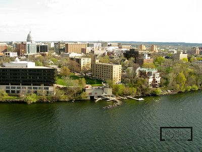 Aerial shot of Madison looking SW from just off James Madison Park on Lake Mendota.  Lifesaving Station, Verex Plaza, and Capitol building.  © Copyright m2 Photography - Michael J. Mikkelson 2009. All Rights Reserved. Images can not be used without permission.