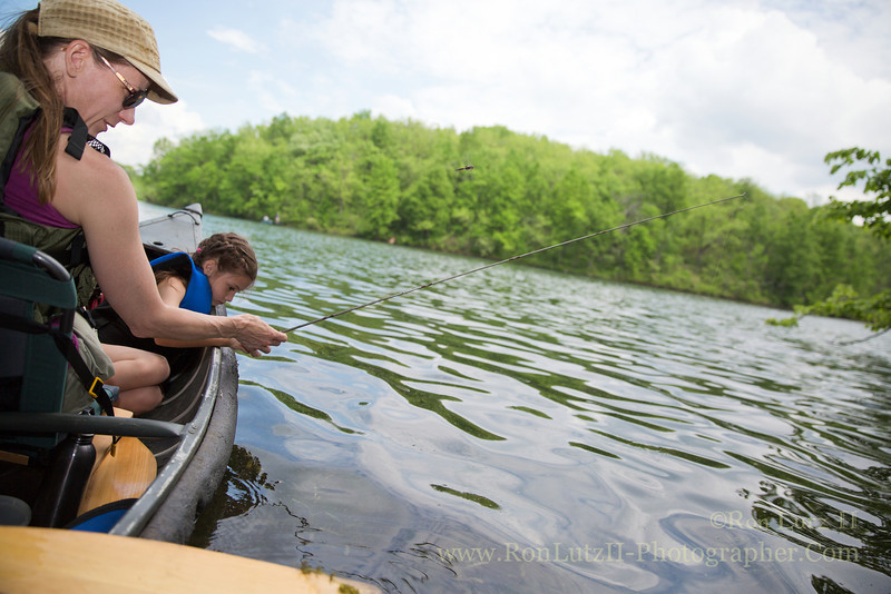 "On a whim I bought a fishing license. The kid has been asking me to take her fishing, and today was finally the day I did so. We canoed across Twin Valley Lake in Governor Dodge State Park. There we wedged our canoe onto a fallen tree under some nice shade. I'd taken the top end off an old, metal fly rod, tied some line to it, attached a small hook, a few split shot weights, and ""PRESTO!"" The kid had a perfect sized cane pole! She caught a number of really nice sized panfish, such as Bluegill, in a short span of time. The bonus of using the cane pole was that there were no tangle lines, or trying to learn how to cast!"