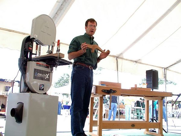 <br><br><font size=3>...and woodworkers doing demonstrations.  This fellow demonstrated a technique for making Queen Anne style legs on the band saw.</font>