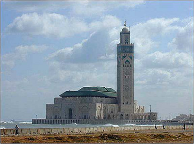 "The Grand Mosque of Hassen II. This is the second largest Mosque in the world, second only to the mosque in Mecca. The mosque has been built out from the natural shoreline on a reclaimed embankment in deliberate fulfillment of the Koranic verse, ""The throne of God was built on the water."""