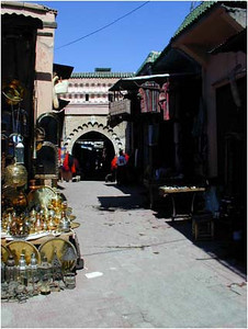 """Like all Moroccan cities, Marrakech has a main gate giving entrance to the Medina. This Medina seemed different from others we have seen.   It was crowded and bustling with activity. It was a maze of passages, easy to become lost, easy to recover. It was a mixture of sight, sound, texture, color and smell. In none of this was it """"different."""" I think what made it different was that visitors to the Medina seemed more international. We heard many non-Moroccan languages. Tourists seemed to dress in a more international tourist style."""