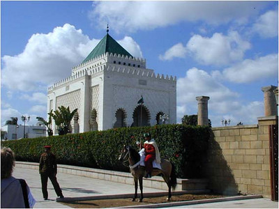 The mausoleum of King Mohammed V was built in 1971 and is lavishly ornate. Every visible surface is decorated, much of it guilded.   Inside hang heraldic banners from all the towns and provinces of Morocco. A Koranic scholar is always present reading the Koran out loud.