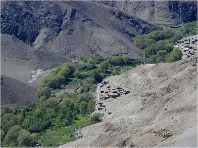 Near the top of the climb on the eastern slopes, we look down at one of the last desert villages we will see.