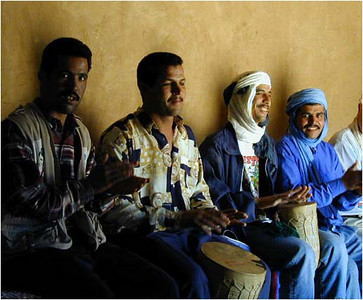 Our drivers picked up drums and put on a little pick up show for us. Singing and playing, their energy and sheer good fun entranced us.  Want to hear Berber music? While in Marrakech, I bought a CD of Berber folk music (but that's another story).