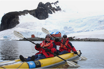 Here my wife and I are kayaking once again. The devices around our necks are emergency transmitters. In the event our kayak is swamped or we become lost, they will lead rescuers to us. We are exploring Antarctica from the lap of luxury. During one of our kayak expeditions, one of the crew went from kayak to kayak in a zodiac offering hot chocolate laced with Peppermint Schnapps. We were requested not to activate our emergency transmitter to get a second cup chocolate; that doing so would not be welcomed with love or affection.