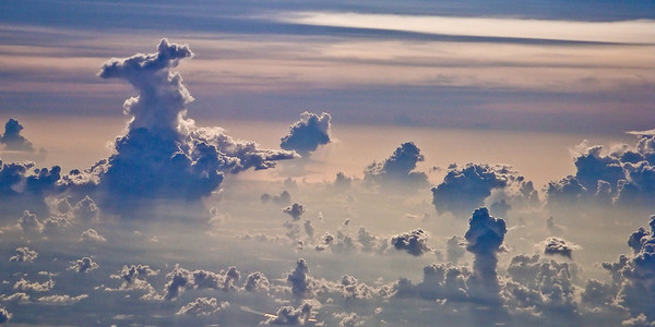 I love looking out the window during a flight, any flight, and this was no exception. The view of the ground yields an exceptional perspective! The view of the clouds! The view of other aircraft! The perspective of angels! This, as almost always, was pretty neat!