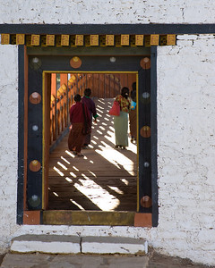 I mentioned previously that the location of the Dzong was defensible. In fact, to reach it you must cross a bridge which has been recently rebuilt in anticipation of the coronation. This is a view through a gateway onto the bridge deck.